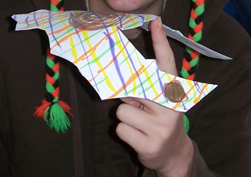 A finished bat-shaped center of gravity wing