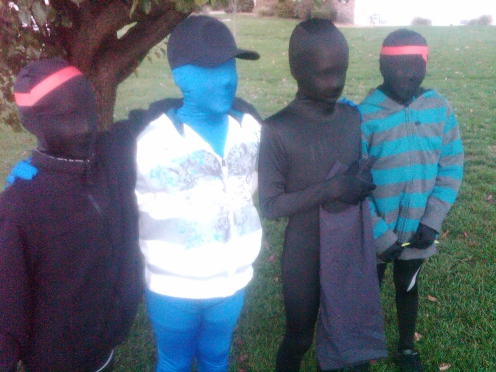 Trick-or-treaters dressed in zentai / morphsuits