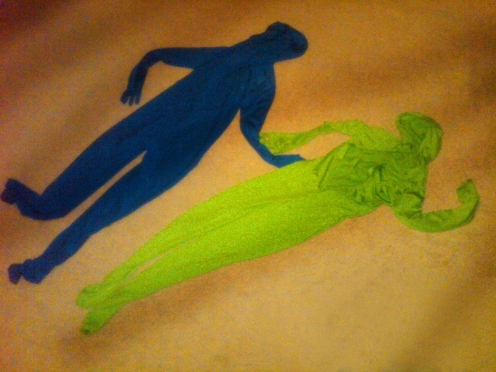 A pair of empty zentai suits on the floor