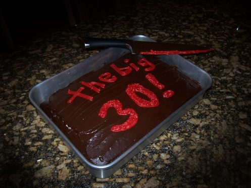 "Cake with red icing words of ""the big 30!"""