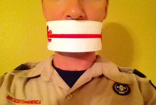 Man wih mouth gagged by order of the arrow sash